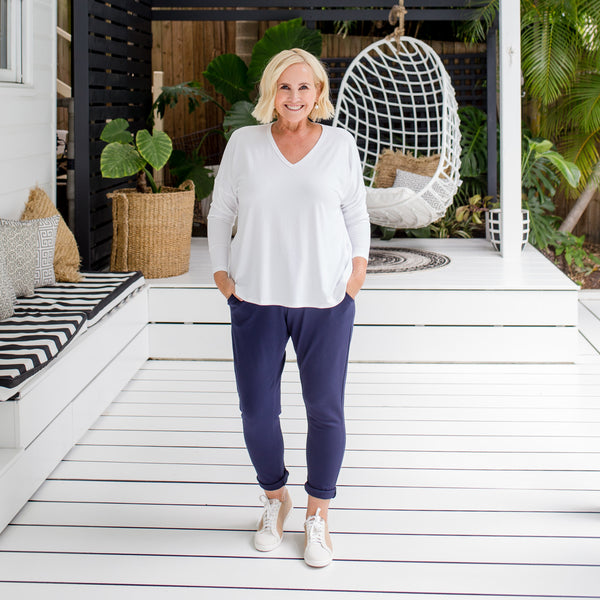 Nikki in our Suzie ponte jogger pant navy (size 12), and our Sharon relaxed long sleeve tee white (size 12), with white sneakers
