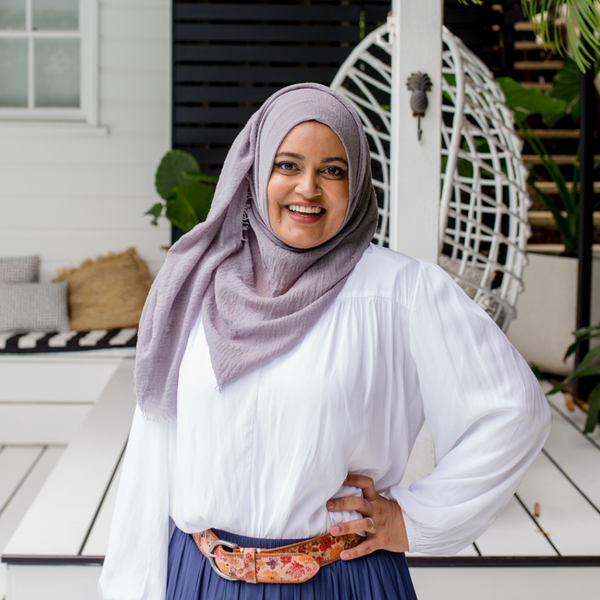 Faaiza our size 10 model wearing our Felicity blouse in white.