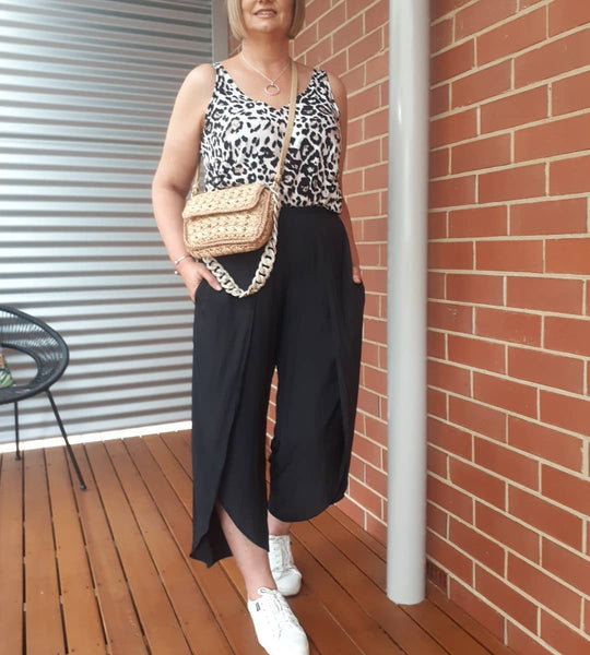 @Julesl65mystyle wearing our Brooke animal print cami and our Maria black technical split pants
