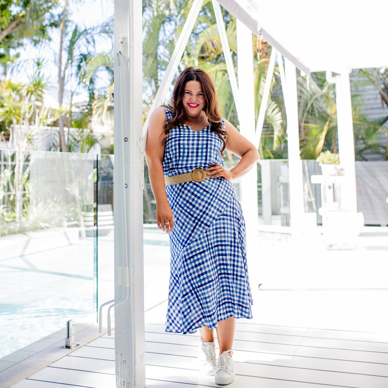 Stacey in our Alexa Cami gingham, our Ashlee midi skirt gingham, paired with a brown belt and white sneakers
