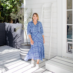 Bec wearing our Kimba gingham button-up shirt tucked into Ashlee midi skirt in gingham with white sneakers