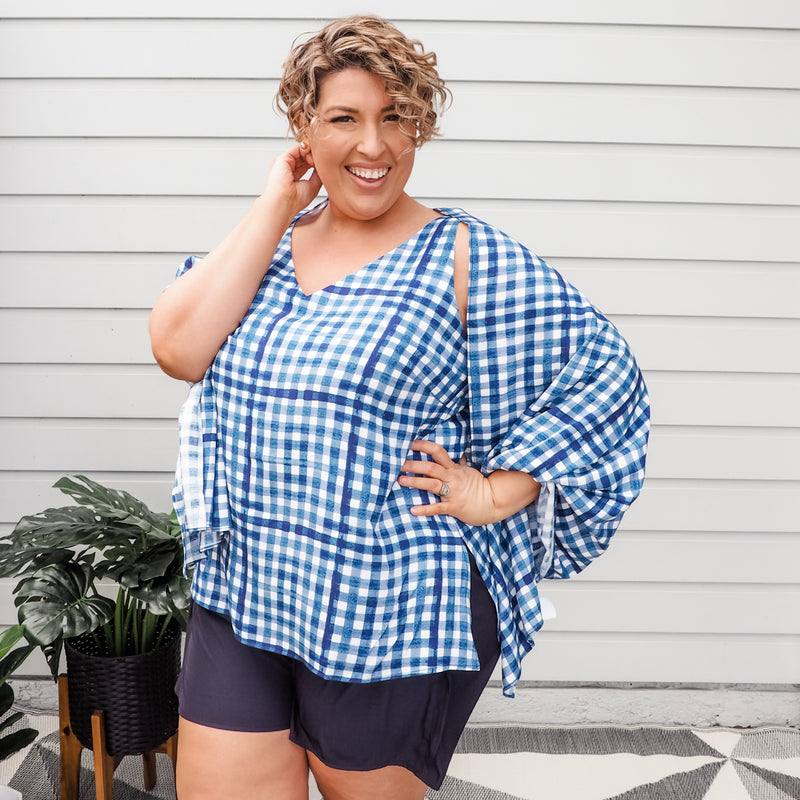 Jo in our Alexa Cami Gingham and our Bec technical shorts in Navy and our Emily scarf/wrap in gingham