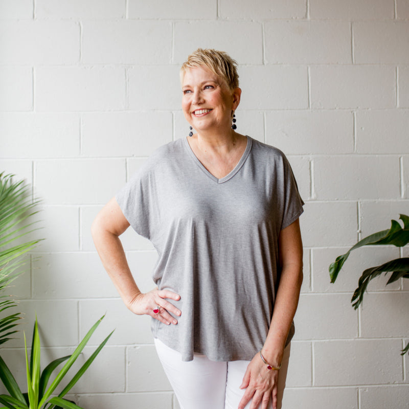 Alexa relaxed tee in grey, and Margaux white denim jeans.