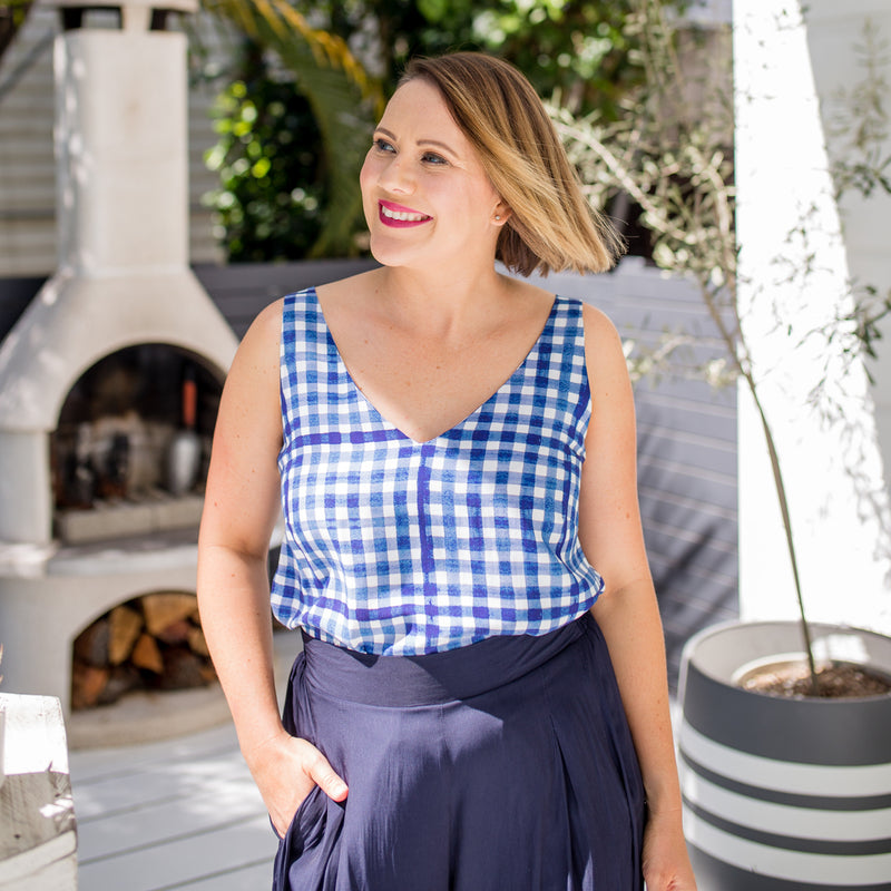 Bec in our Alexa Cami gingham and our Maddy Technical Pant in navy