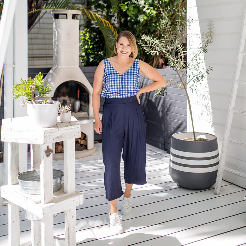 Bec in our Alexa Cami gingham and our Maddy Technical Pant in navy paired with white sneakers