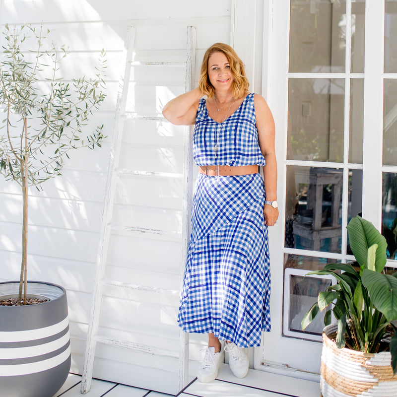 Karen in our Alexa Cami gingham, our Ashlee midi skirt gingham, paired with white sneakers and a brown belt