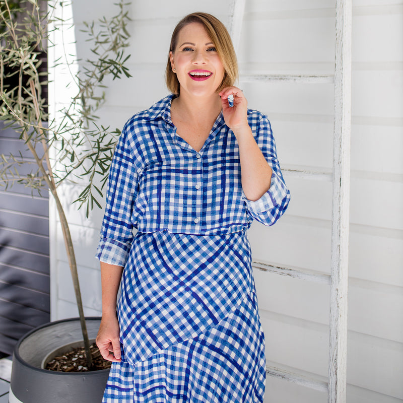 Bec wearing our Kimba shirt in gingham with our Ashlee midid skirt gingham