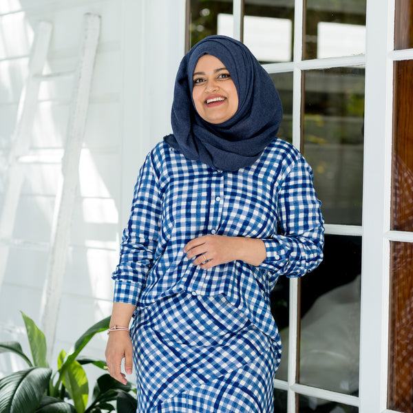 Faaiza wearing our Kimba shirt in gingham with our Ashlee midid skirt gingham