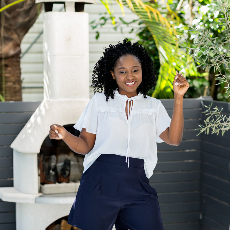 Sonia in our Kim technical blouse white and our Bec technical shorts navy