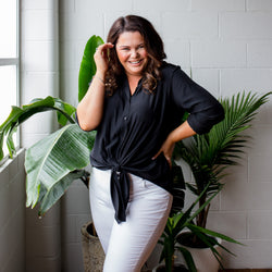 Stacey in our Cate technical shirt - black and our Margaux jean - white denim