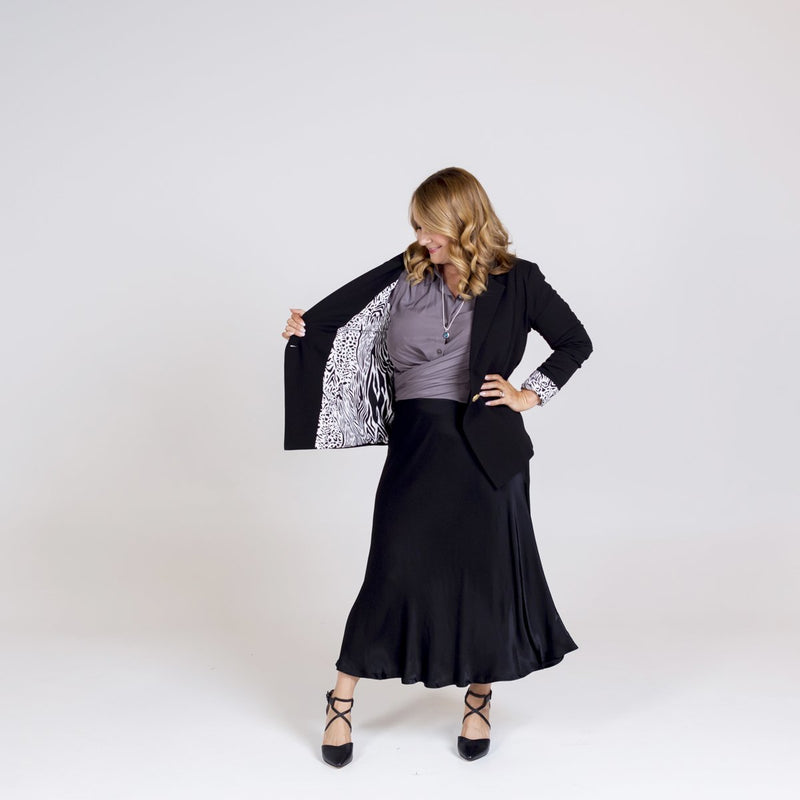 Kerryn blazer black with Cate technical shirt sage and Deborah midi skirt black.