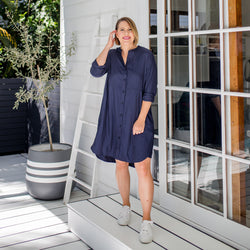 Bec wearing our Danielle technical shirt dress in navy paired with white sneakers