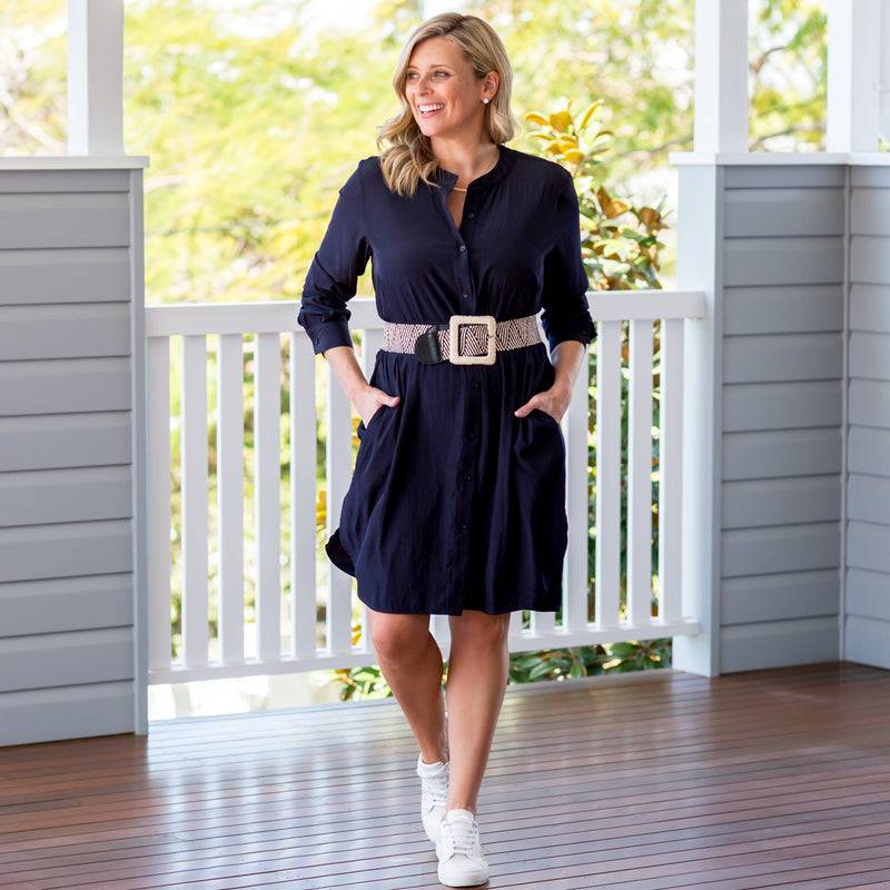 Brooke wearing our Danielle technical shirt dress navy paired with white sneakers and a chunky belt
