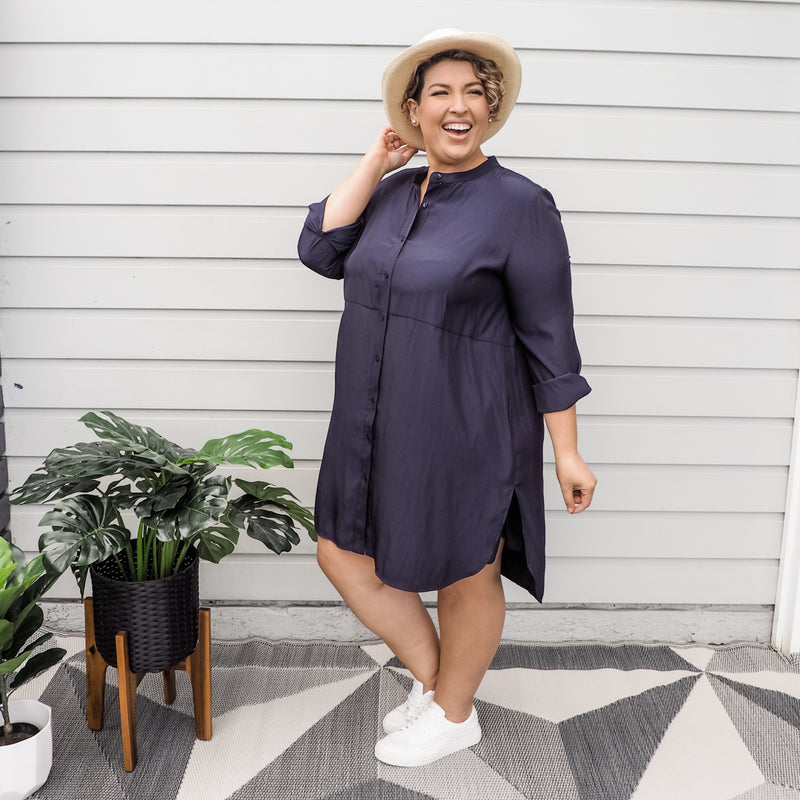 Jo wearing our Danielle technical shirt dress in navy paired with white sneakers