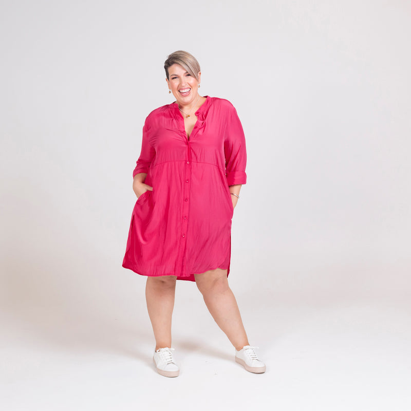 Danielle technical shirt dress raspberry, styled with white sneakers.