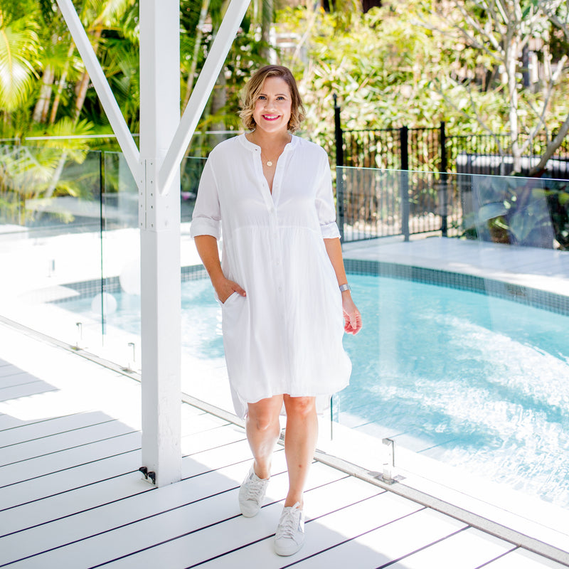 Bec wearing our white Danielle technical shirt-dress with white sneakers