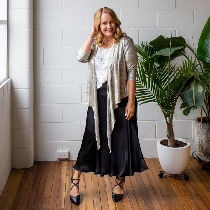 Susan wrap cardi gold, styled with Shanna relaxed tee white and Deborah midi skirt black.