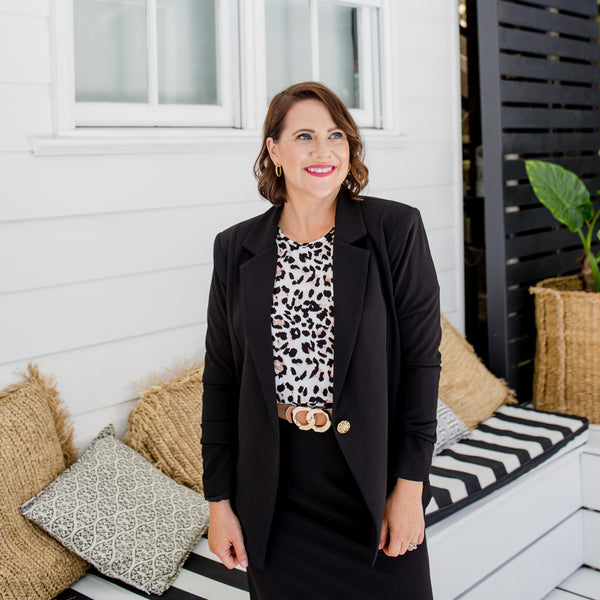 Bec  is wearing our Helen Blazer in Black on top of Ingrid Long sleeve tee in animal print tucked into Fiona pencil skirt in black with tan belt
