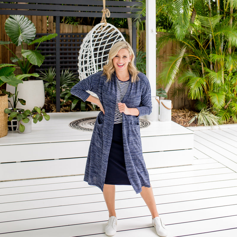 Brooke is wearing our Jalena longline cardigan in navy marle on top of the Melinda stripe tee in navy and white tucked into Fiona scuba pencil skirt in navy with white sneakers.
