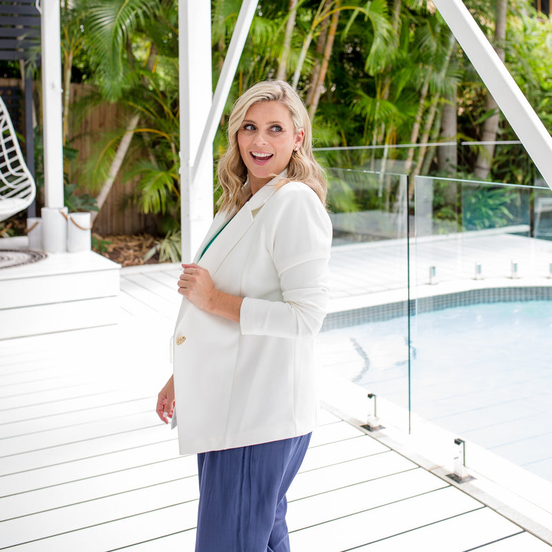 Brooke is wearing Helen scuba blazer in ivory with Maddy technical crop pants in steel blue.