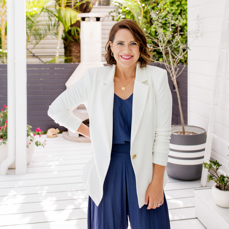 Bec is wearing our Helen Scuba blazer in Ivory on top of Rachael technical cami in steel blue tucked into Maddy technical crop pant in steel blue.
