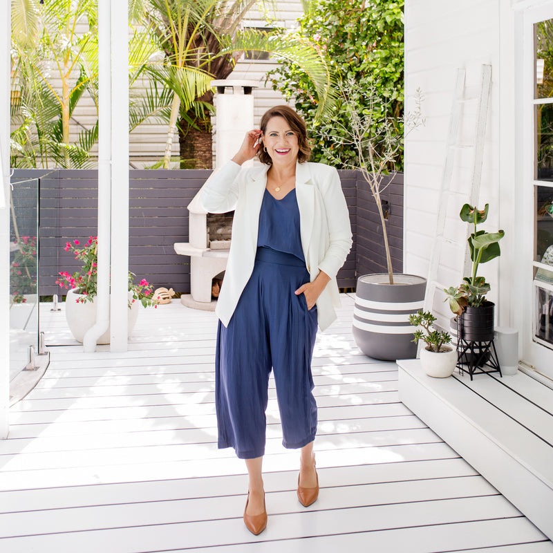 Bec is wearing our Helen Scuba blazer in Ivory on top of Rachael technical cami in steel blue tucked into Maddy technical crop pant in steel blue and tan shoes.
