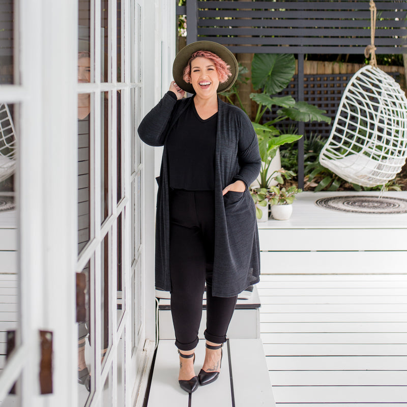 Jo wearing our Jalena long line cardigan in black over our black Sharon long sleeve tee and black Suzie Ponte jogger pants. She has styled this with black heels and a khaki fedora.