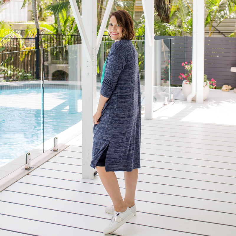 Bec is wearing our Jalena longline cardigan in navy marle on top on Fiona scuba pencil skirt in navy and white sneakers