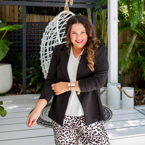 Stacey  is wearing our Helen blazer in black on top of Jenny swing knit in Ivory and Leanne Joggy pants in animal print