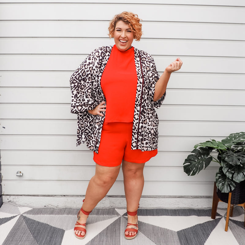 Jo wearing our Red Sonia playsuit with our Peta duster in animal print and Red heels.