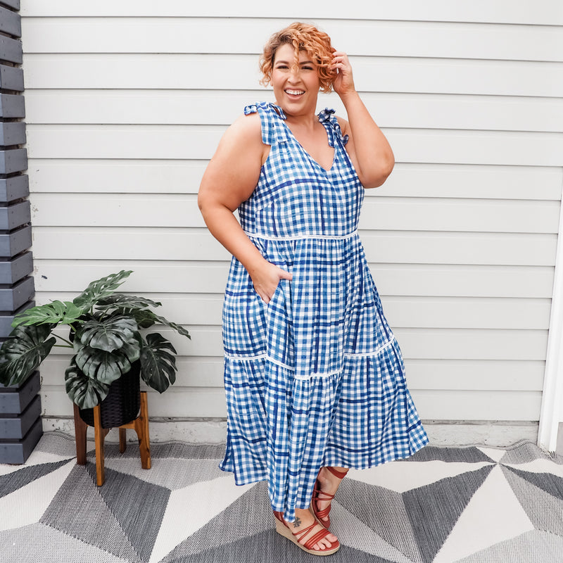 Jo wearing our Vanessa tie-shoulder dress in gingham with red wedges.
