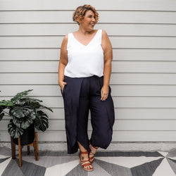 Jo wearing our navy Maria split pants with our Rachael technical cami in white