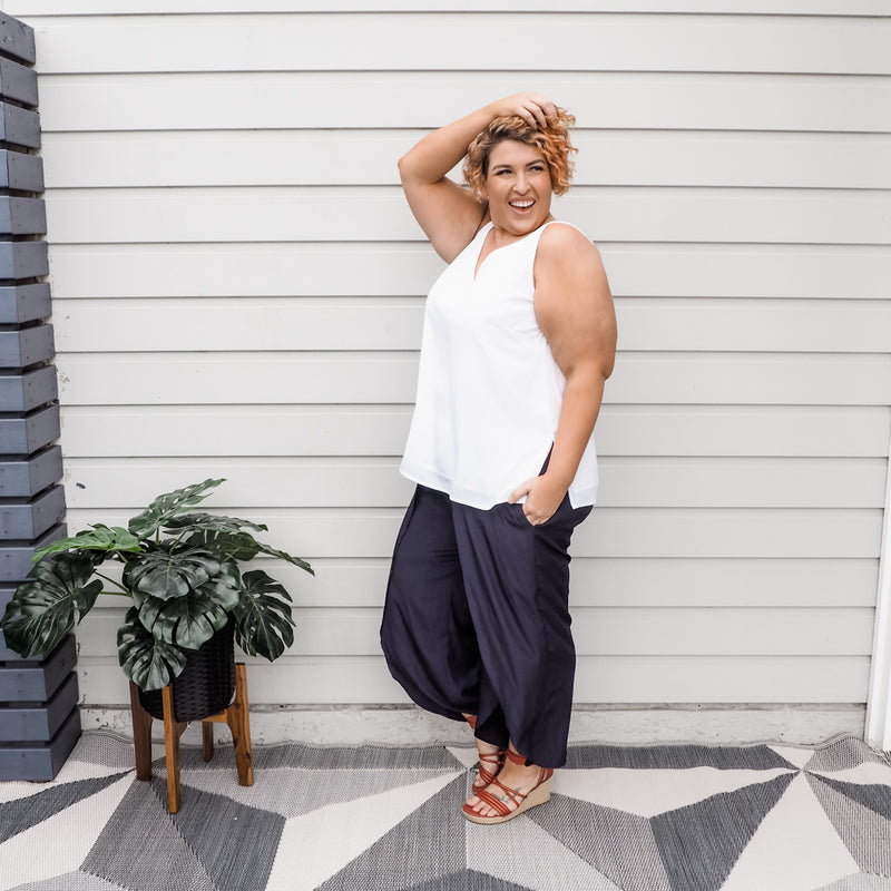 Jo wearing our Rachael technical cami in white with our navy Maria technical split pants.