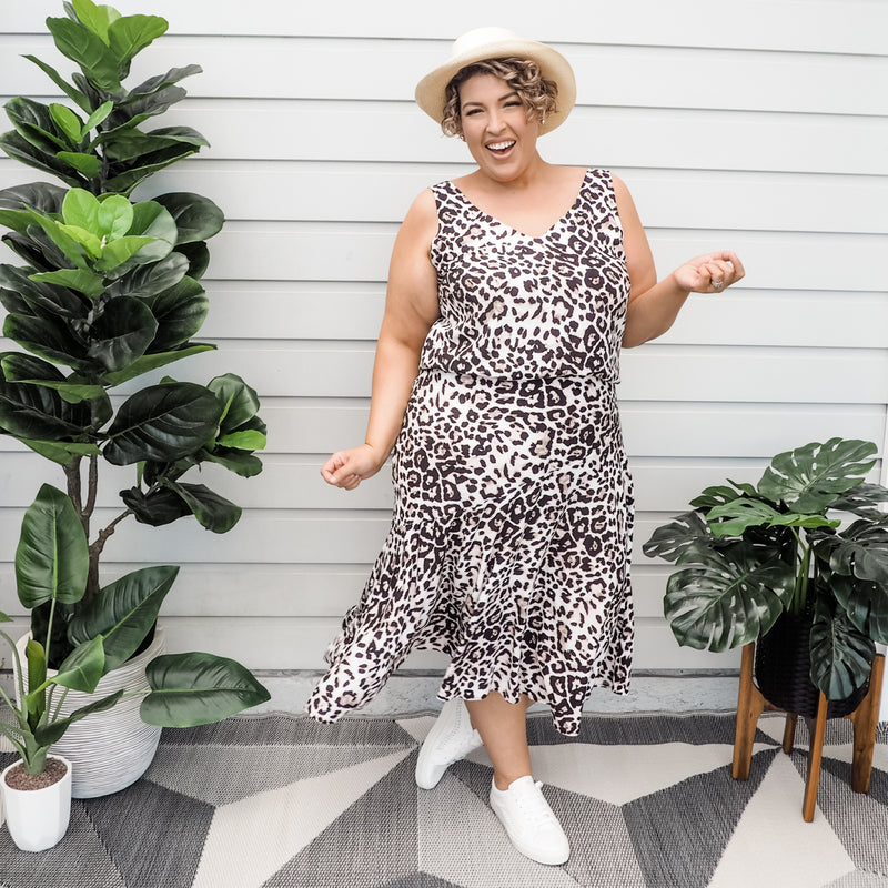 Jo wearing our Kutira midi skirt - animal print with our Brooke cami - animal print with white sneakers and a hat
