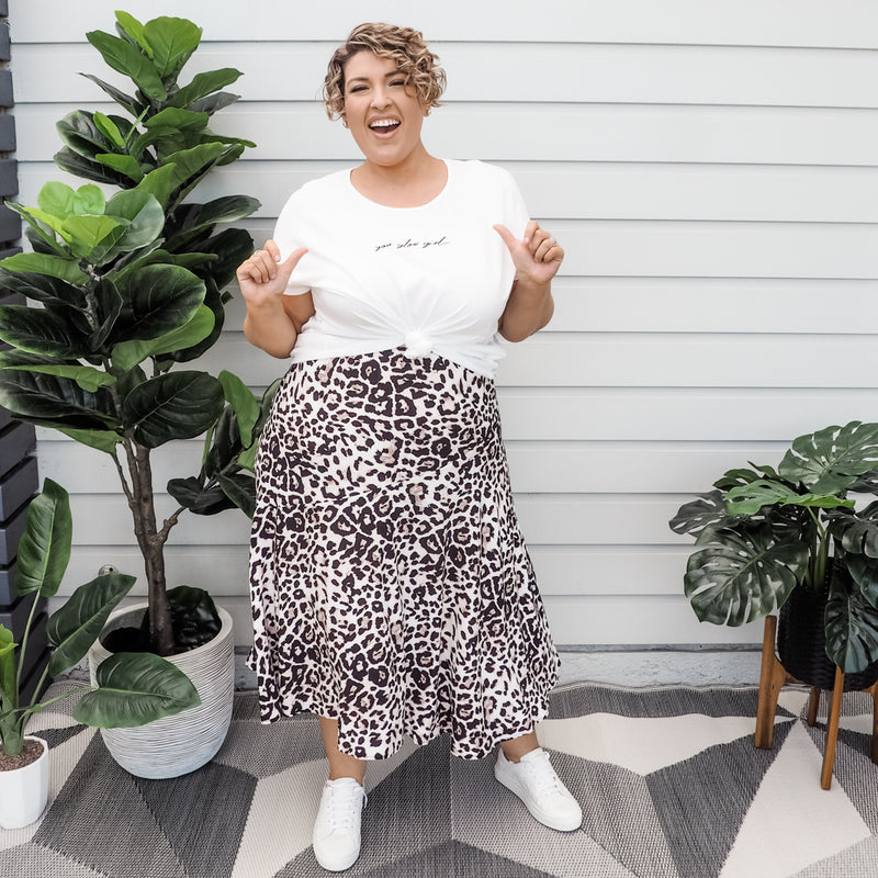 Jo in our Tanya relaxed tee - white and our  Kutira midi skirt - animal print paired with white sneakers