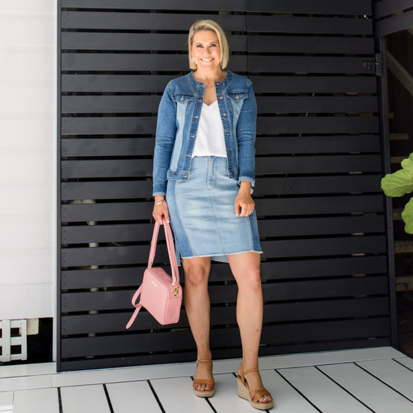 Bec in our Beth denim skirt and our Jodie jacket - denim paired with brown heels and a pink bag