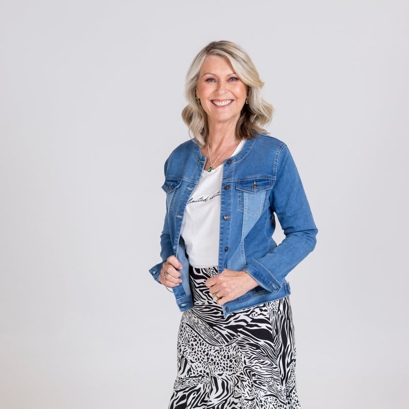 Kim wearing our Jodie denim jacket over our white Shanna relaxed tee tucked into our Rylee midi skirt in Safari.