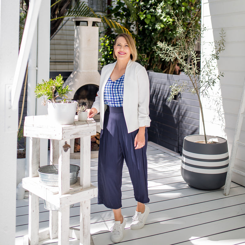Bec in our Alexa Cami gingham and our Maddy Technical Pant in navy and our Karen Scuba Jacket ivory paired with white sneakers