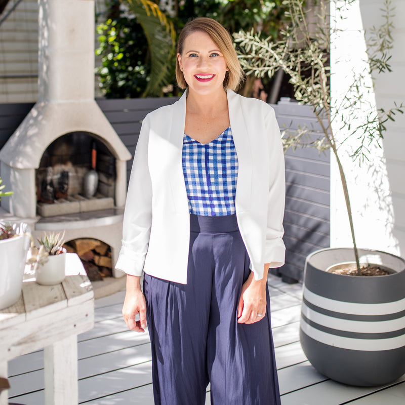 Bec in our Alexa Cami gingham and our Maddy Technical Pant in navy and our Karen Scuba Jacket ivory