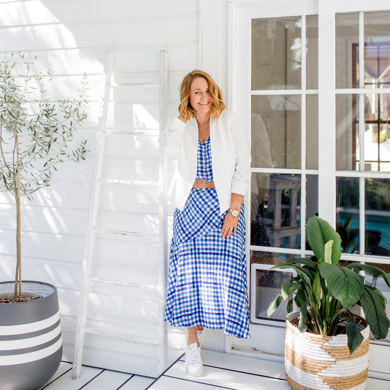 Karen in our Alex Cami gingham, our Ashlee midi skirt gingham and our Karen Scuba Jacket in ivory, paired with a brown belt and white sneakers