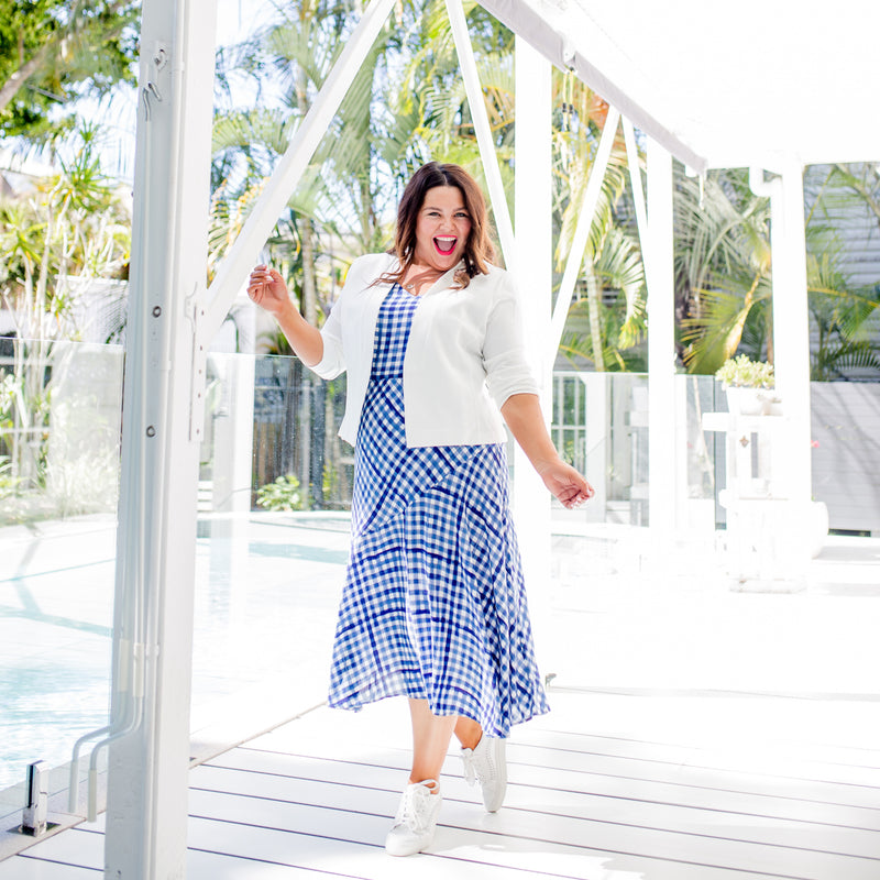 Stacey in our Alexa Cami gingham, our Ashlee midi skirt gingham and our Karen Scuba Jacket in ivory paired with white sneakers