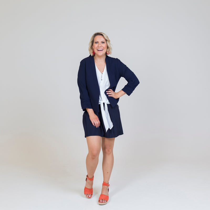 Karen scuba jacket - navy paired with our Cate technical shirt - white, our Bec shorts in navy and orange sandals