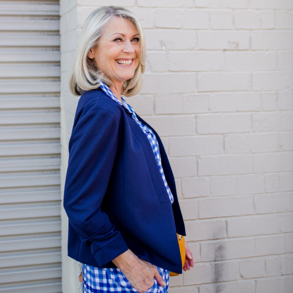 Karen scuba jacket - navy paired with our Kimba Gingham top, our Grace Gingham shorts and a yellow handbag