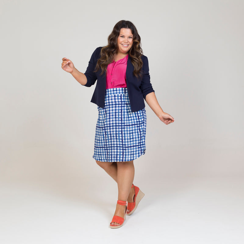 Karen scuba jacket - navy paired with a pink top, a gingham print skirt and orange heels