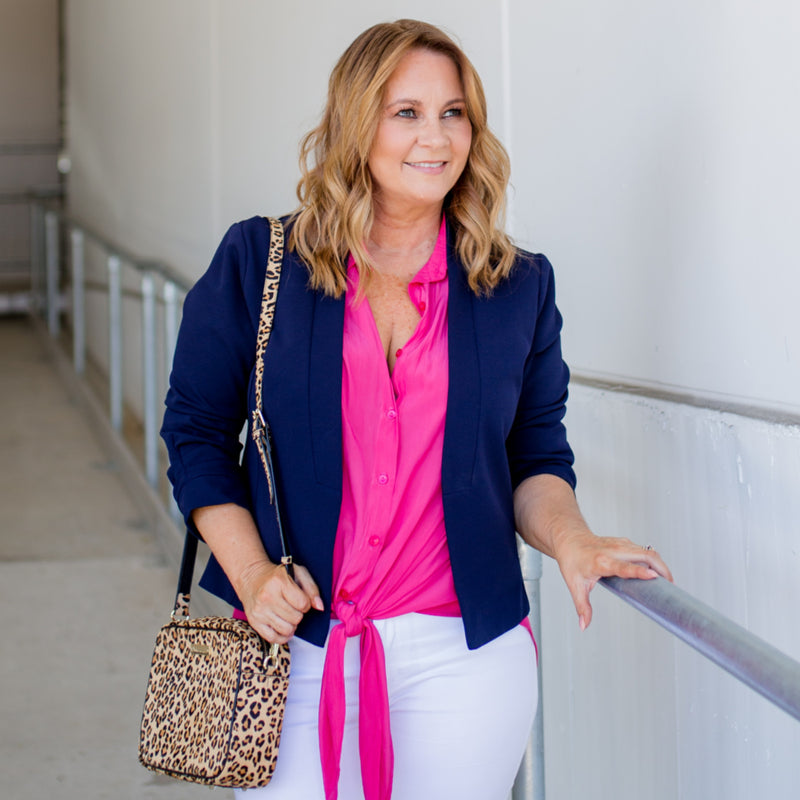 Karen scuba jacket - navy paired with a pink top, white jeans and a leopard handbag