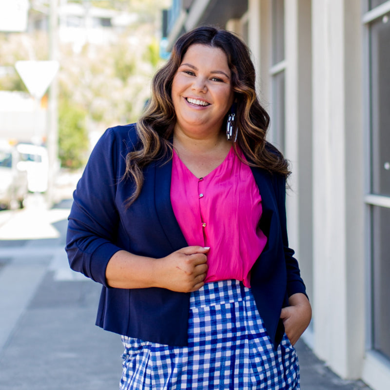 Karen scuba jacket - navy paired with a pink top and a gingham print skirt.