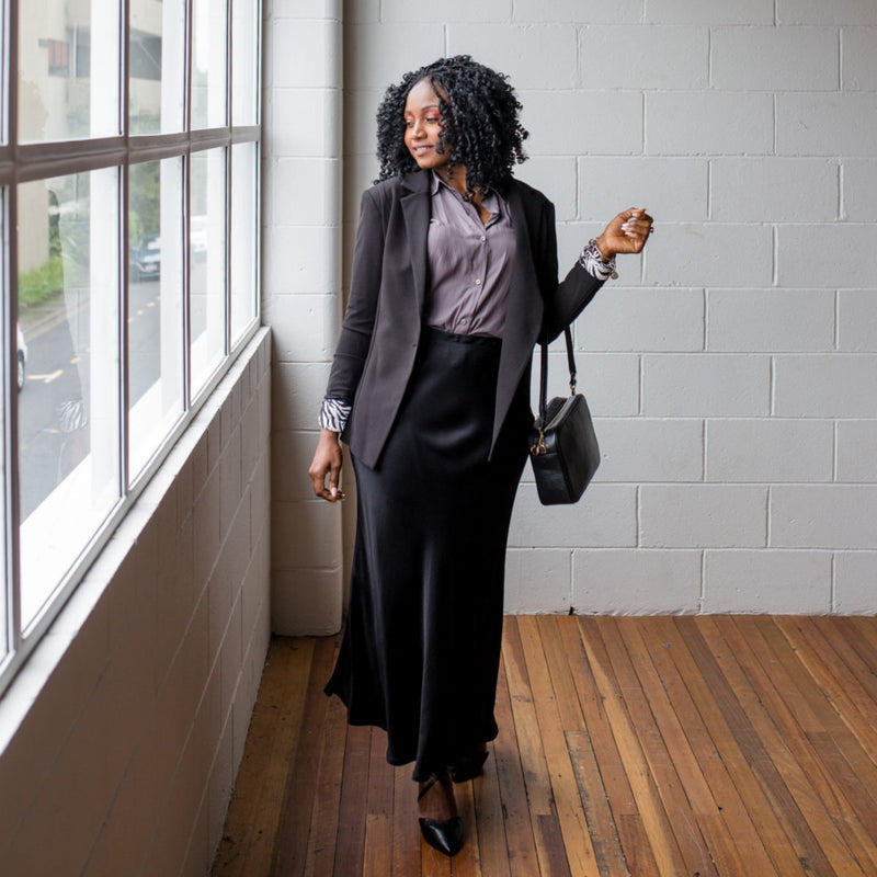 Kerryn blazer black with Cate technical shirt sage and Deborah midi skirt black. Styled with black bag.