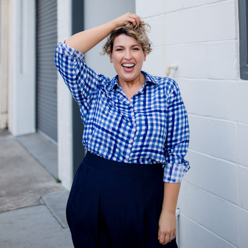 Jo wearing our Kimba shirt in gingham with our Maddy technical crop pants in navy