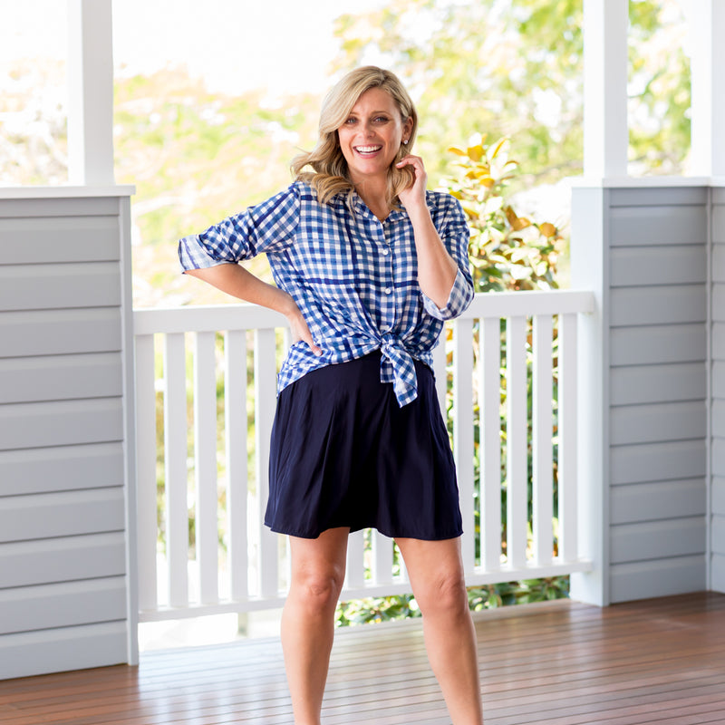 Brooke wearing our Kimba shirt gingham and our bec technical shorts in navy