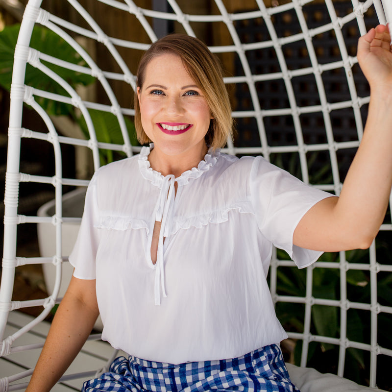 Bec in our Kim technical blouse white and our Grace shorts gingham